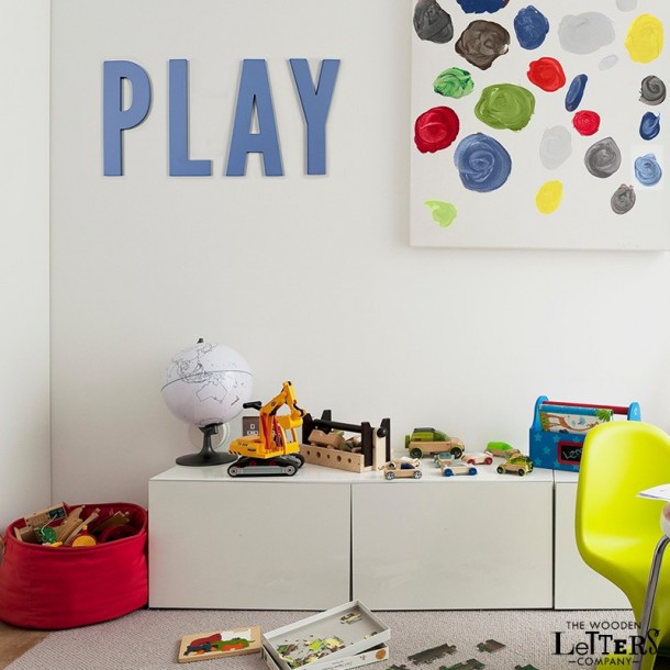 PLAY wooden letters in child's nursery room