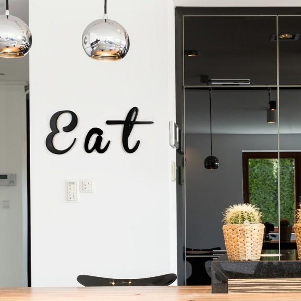 Black EAT Retro Script letters in kitchen