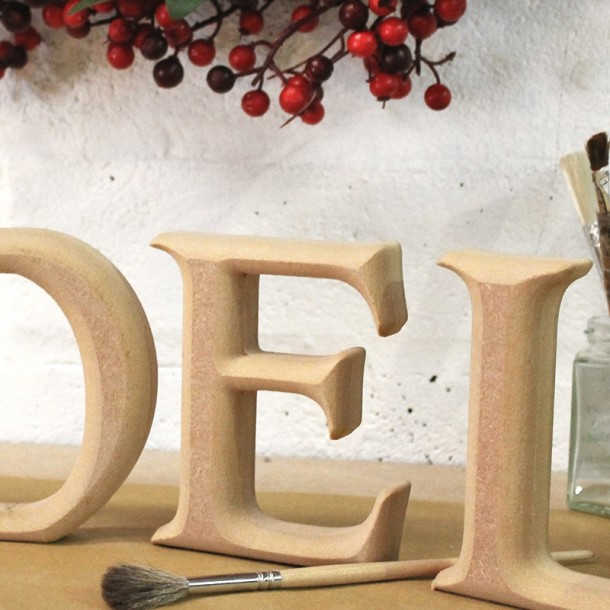 Carved NOEL letters, unpainted