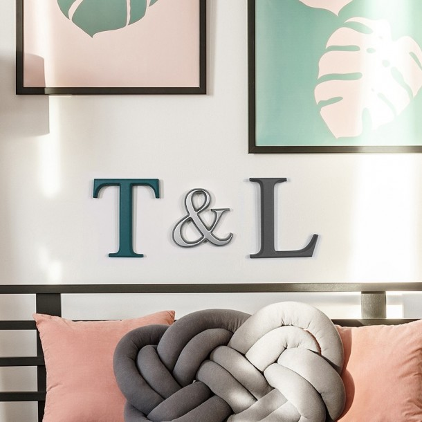 Teal grey silver painted letters on wall